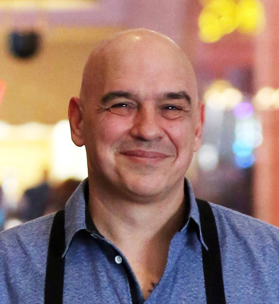 Michael Symon, chef and owner of Mabel's BBQ, poses for a photo at his restaurant at The Palms on Thursday, Dec. 20, 2018, in Las Vegas. Bizuayehu Tesfaye Las Vegas Review-Journal @bizutesfaye