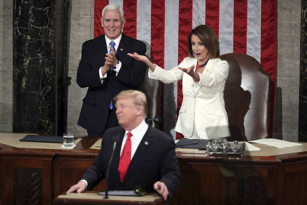 House Speaker Nancy Pelosi gestures to fellow Democrats as President Donald Trump acknowledges women in Congress during his State of the Union address to a joint session of Congress on Capitol Hil ...