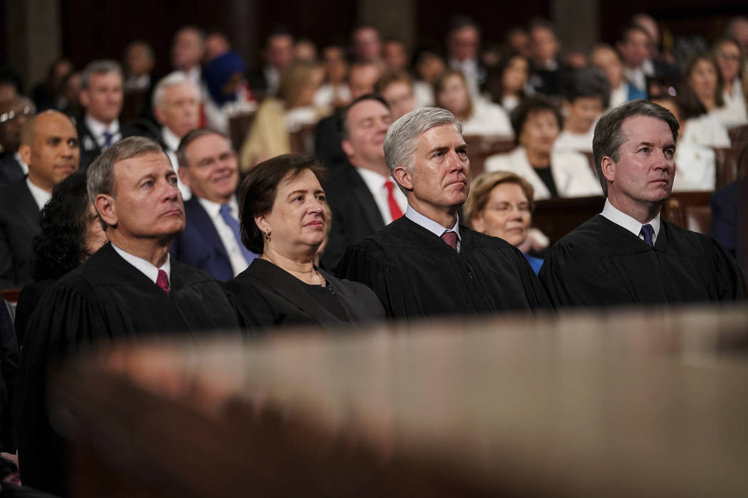 President Donald Trump gives his State of the Union address to a joint session of Congress, Tuesday, Feb. 5, 2019 at the Capitol in Washington, as Supreme Court Justices John Roberts, Elena Kagan, ...