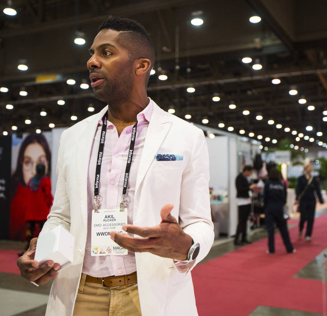 Akil Rucker of OMG! Accessories talks about products during WWDMAGIC, part of the MAGIC trade show, at the Las Vegas Convention Center in Las Vegas on Tuesday, Feb. 5, 2019. (Chase Stevens/Las Veg ...