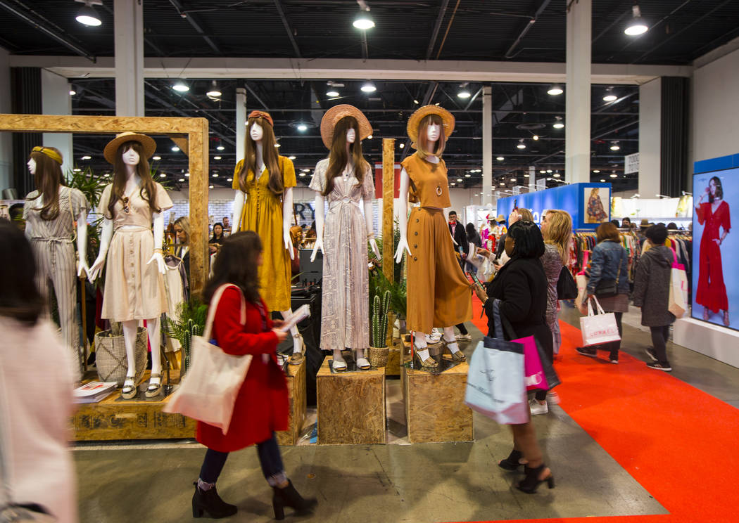 Attendees look at clothing from Very J during WWDMAGIC, part of the MAGIC trade show, at the Las Vegas Convention Center in Las Vegas on Tuesday, Feb. 5, 2019. (Chase Stevens/Las Vegas Review-Jour ...