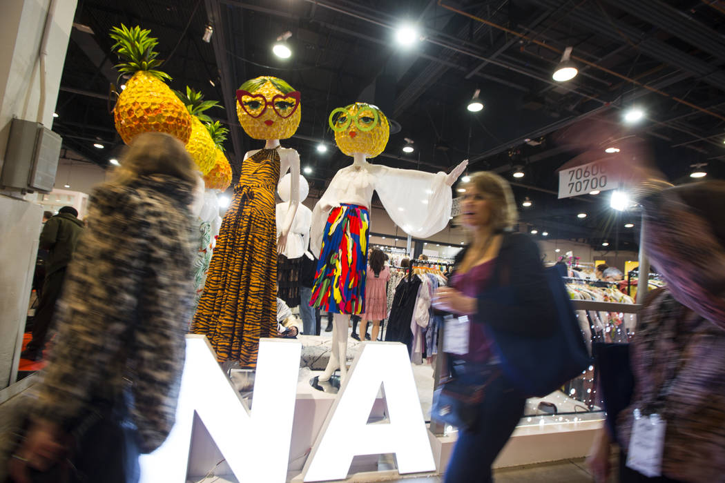 Attendees pass by the INA booth during WWDMAGIC, part of the MAGIC trade show, at the Las Vegas Convention Center in Las Vegas on Tuesday, Feb. 5, 2019. (Chase Stevens/Las Vegas Review-Journal) @c ...