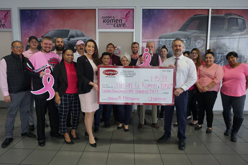 Ryan Payne, general sales manager of Chapman Chrysler Jeep, and staff present check to Chelsea Robinson, executive director of Susan G. Komen Nevada. (Chapman Chrysler Jeep)