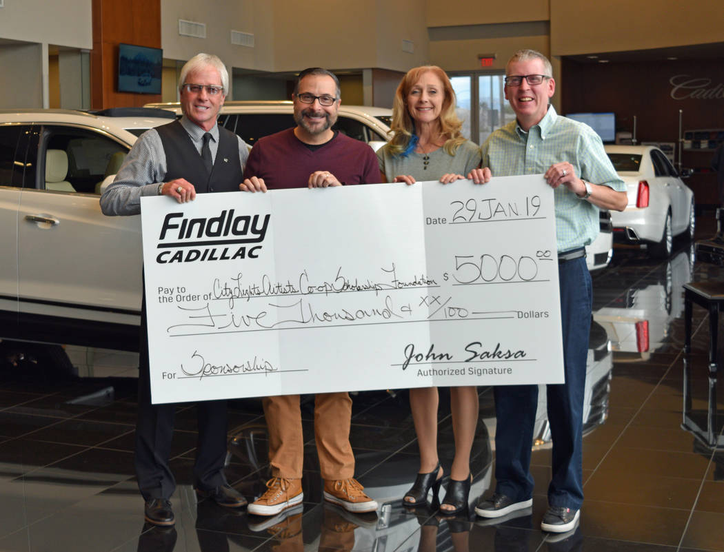 From left, Findlay marketing/sales executive L.J. Harness, dealership general manager John Saksa, City Lights Art Gallery Scholarship fund chairman Susan LaBuda and gallery president Eric Courtney ...