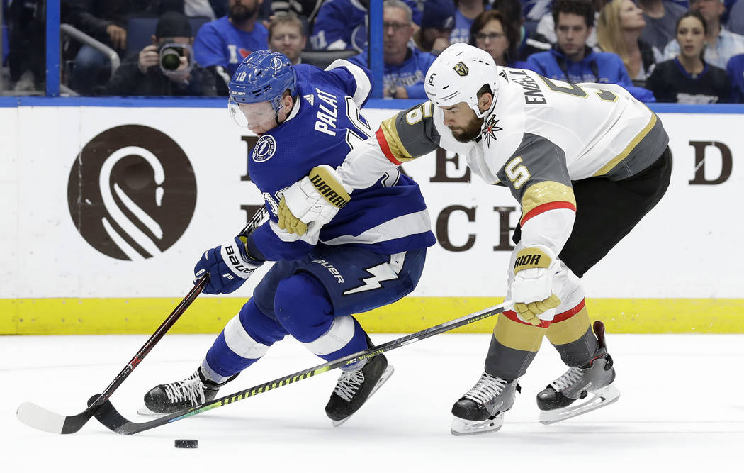 Tampa Bay Lightning left wing Ondrej Palat, left, attempts to get around Vegas Golden Knights defenseman Deryk Engelland, right, during the second period of an NHL hockey game Tuesday, Feb. 5, 201 ...