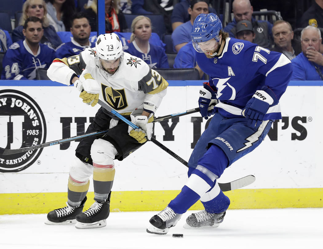 Tampa Bay Lightning defenseman Victor Hedman (77) steals the puck from Vegas Golden Knights center Brandon Pirri (73) during the first period of an NHL hockey game Tuesday, Feb. 5, 2019, in Tampa, ...