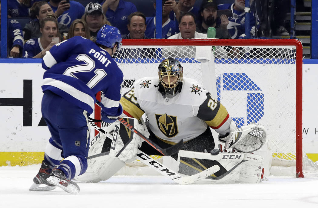 Vegas Golden Knights goaltender Marc-Andre Fleury (29) stops a shot by Tampa Bay Lightning center Brayden Point (21) during a shootout in an NHL hockey game Tuesday, Feb. 5, 2019, in Tampa, Fla. ( ...