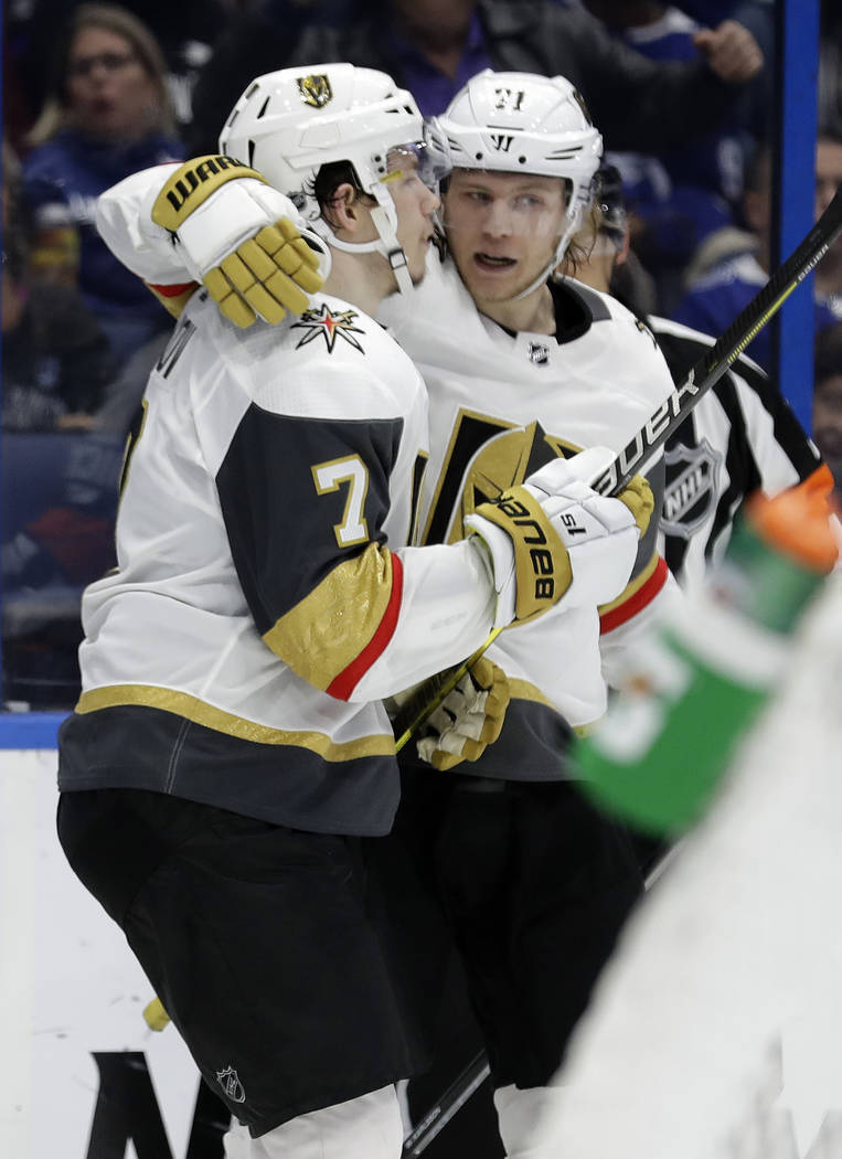 Vegas Golden Knights left wing Valentin Zykov (7) celebrates his goal against the Tampa Bay Lightning with center William Karlsson during the third period of an NHL hockey game Tuesday, Feb. 5, 20 ...