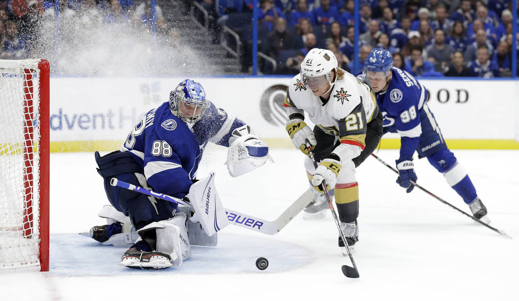 Tampa Bay Lightning goaltender Andrei Vasilevskiy (88) stops a shot by Vegas Golden Knights center Cody Eakin (21) during the third period of an NHL hockey game Tuesday, Feb. 5, 2019, in Tampa, Fl ...