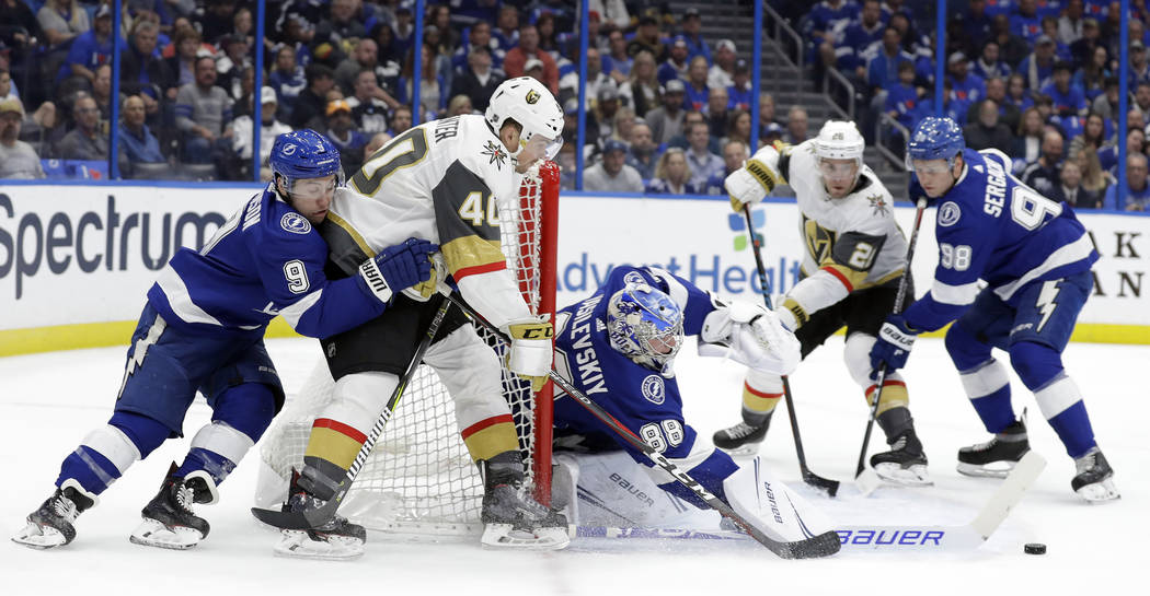 Tampa Bay Lightning goaltender Andrei Vasilevskiy (88) gets his stick on a shot by Vegas Golden Knights center Ryan Carpenter (40) during the first period of an NHL hockey game Tuesday, Feb. 5, 20 ...