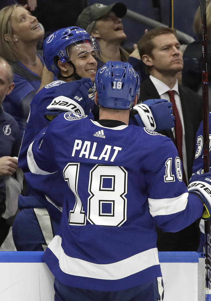 Tampa Bay Lightning right wing Mathieu Joseph, left, celebrates his goal against the Vegas Golden Knights with left wing Ondrej Palat during the second period of an NHL hockey game Tuesday, Feb. 5 ...