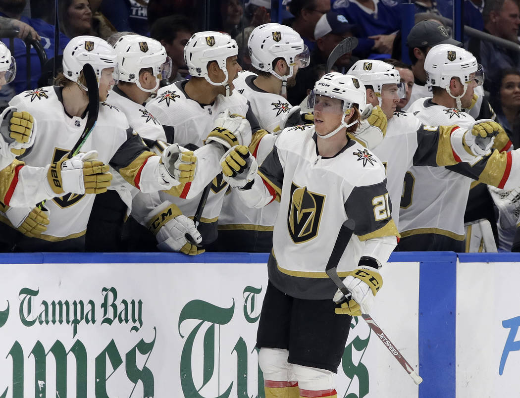 Vegas Golden Knights center Cody Eakin (21) celebrates with the bench after his goal against the Tampa Bay Lightning during the second period of an NHL hockey game Tuesday, Feb. 5, 2019, in Tampa, ...