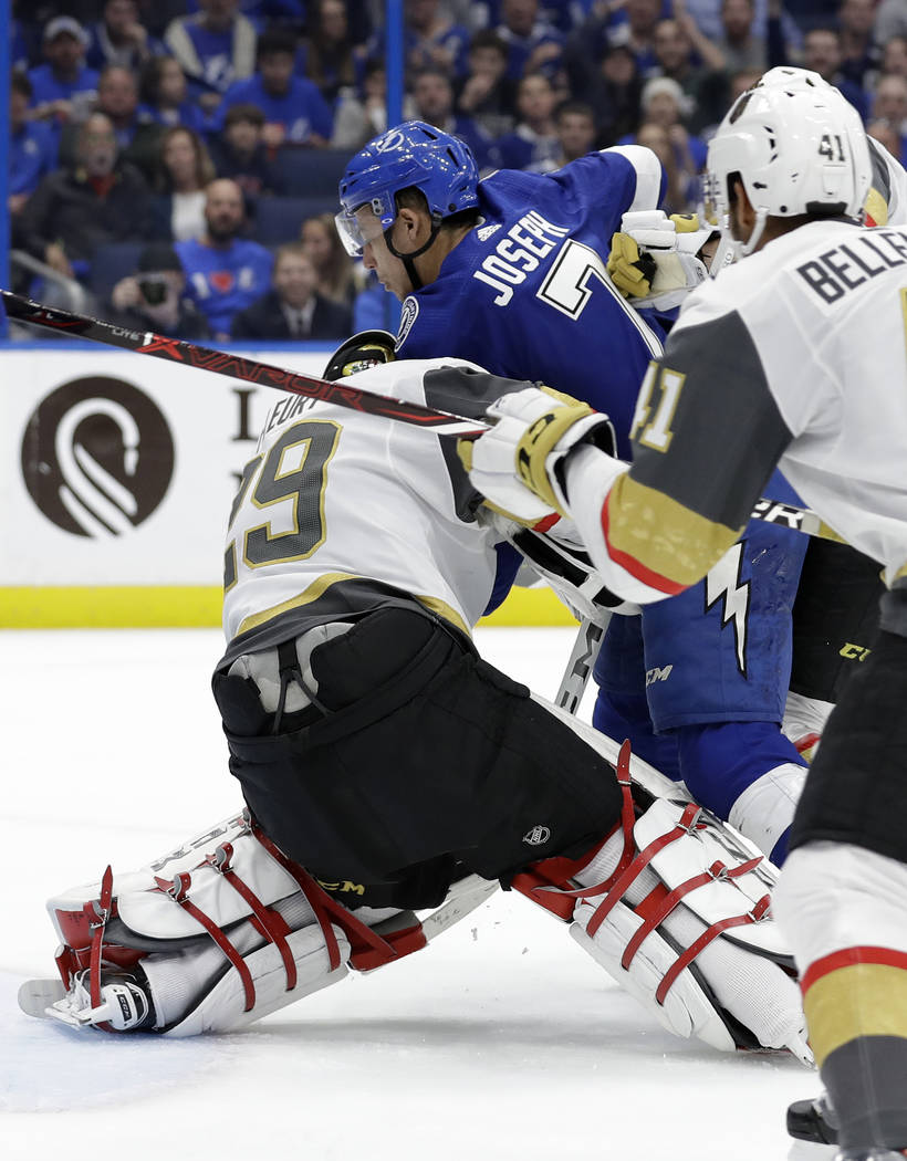 Tampa Bay Lightning right wing Mathieu Joseph runs into Vegas Golden Knights goaltender Marc-Andre Fleury (29) as he scores a goal during the second period of an NHL hockey game Tuesday, Feb. 5, 2 ...