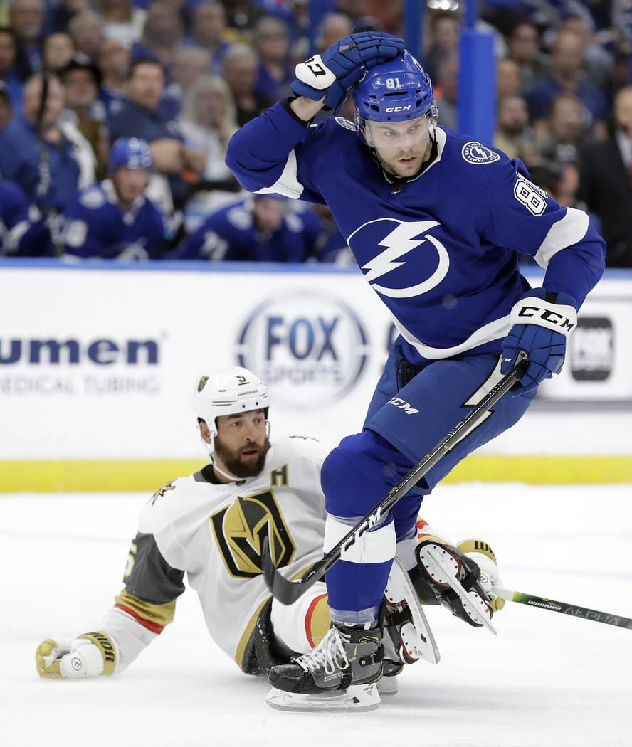 Tampa Bay Lightning defenseman Erik Cernak, right, knocks down Vegas Golden Knights defenseman Deryk Engelland, left, during the first period of an NHL hockey game Tuesday, Feb. 5, 2019, in Tampa ...
