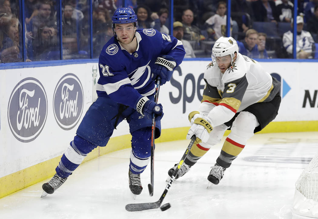 Tampa Bay Lightning center Brayden Point (21) gets around Vegas Golden Knights defenseman Brayden McNabb (3) during the second period of an NHL hockey game Tuesday, Feb. 5, 2019, in Tampa, Fla. (A ...