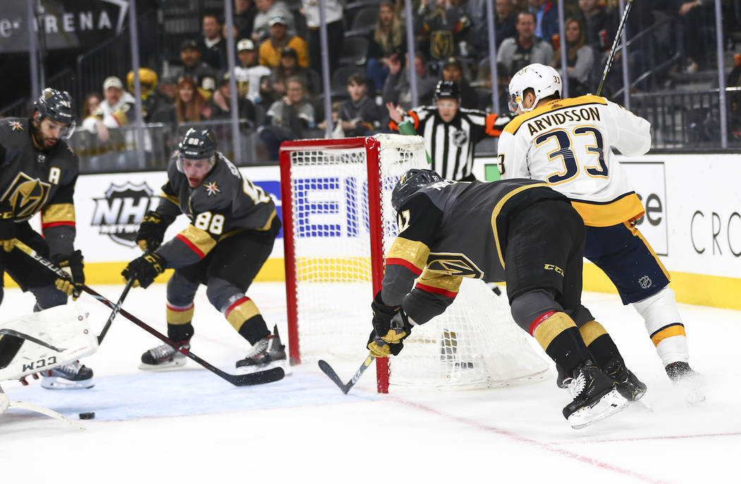 Golden Knights defenseman Nate Schmidt (88) stops an attempted goal by Nashville Predators right wing Viktor Arvidsson (33) during the third period of an NHL hockey game at T-Mobile Arena in Las V ...
