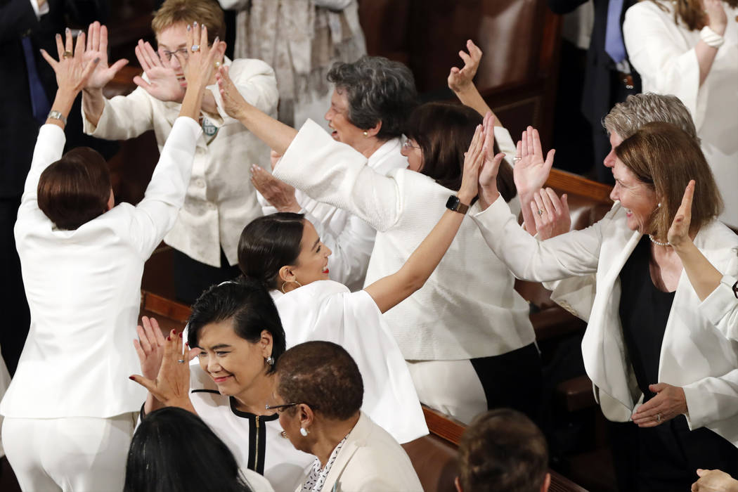 Women members of Congress, including Rep. Alexandria Ocasio-Cortez, D-N.Y., center, cheer after President Donald Trump acknowledges more women in Congress during his State of the Union address to ...