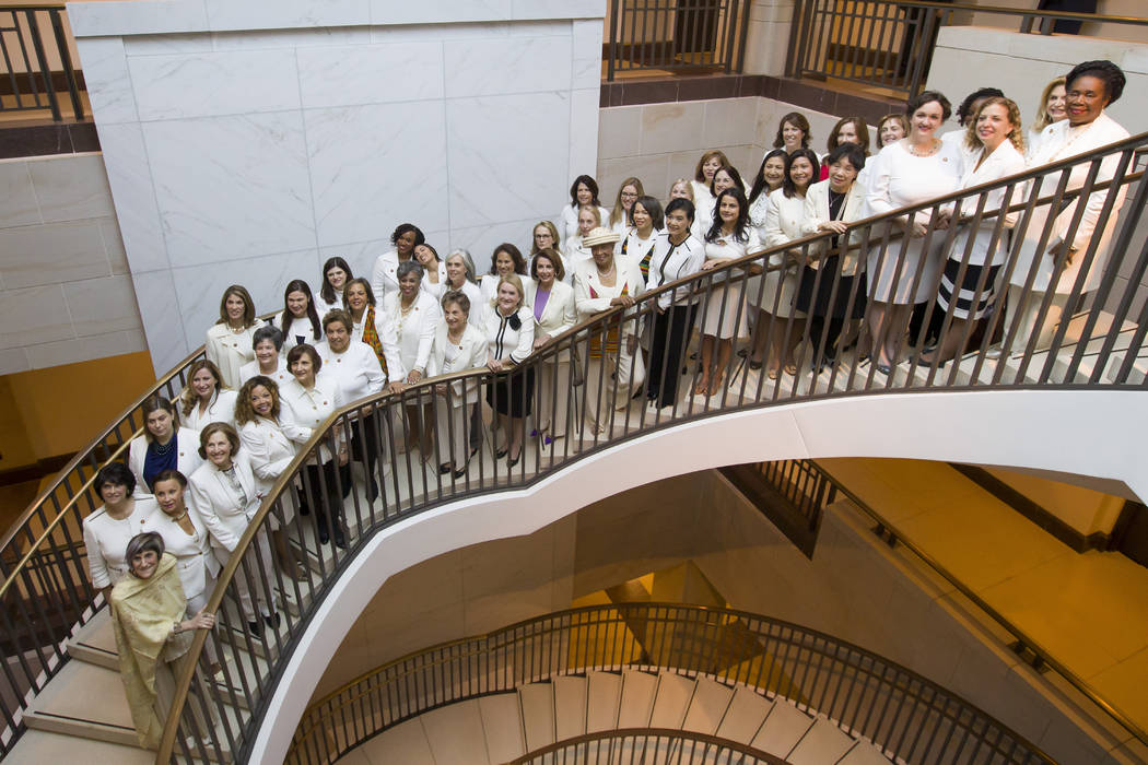 House Speaker Nancy Pelosi of Calif., center, is joined by other women wearing white, as they pose for a group photo before the State of the Union address by President Donald Trump, on Capitol Hil ...
