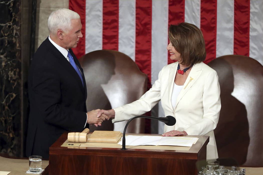 House Speaker Nancy Pelosi greets Vice President Mike Pence before President Donald Trump delivers his State of the Union address to a joint session of Congress on Capitol Hill in Washington, Tues ...