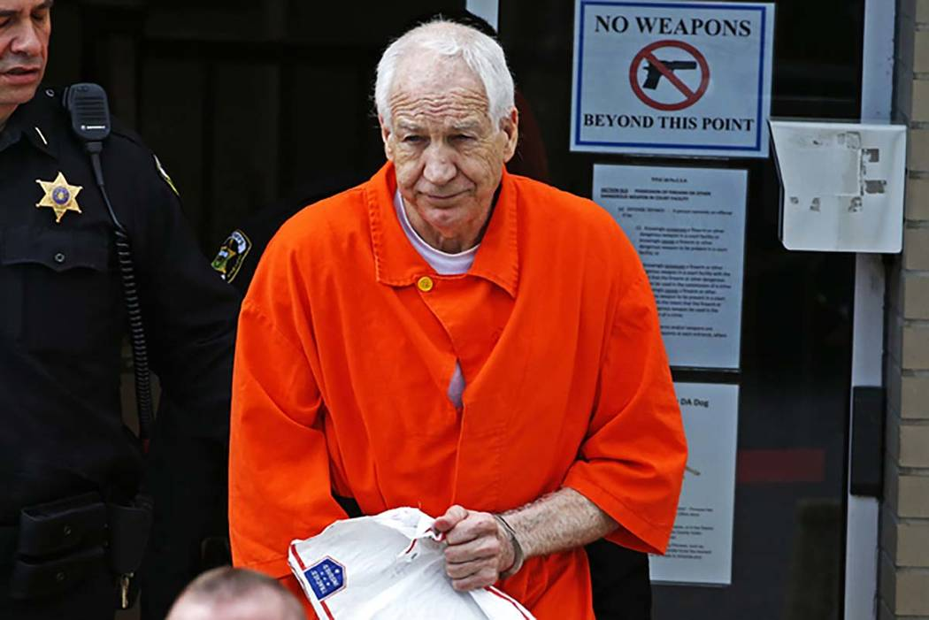 Former Penn State University assistant football coach Jerry Sandusky leaves the Centre County Courthouse after a hearing of arguments on his request for an evidentiary hearing as he seeks a new tr ...