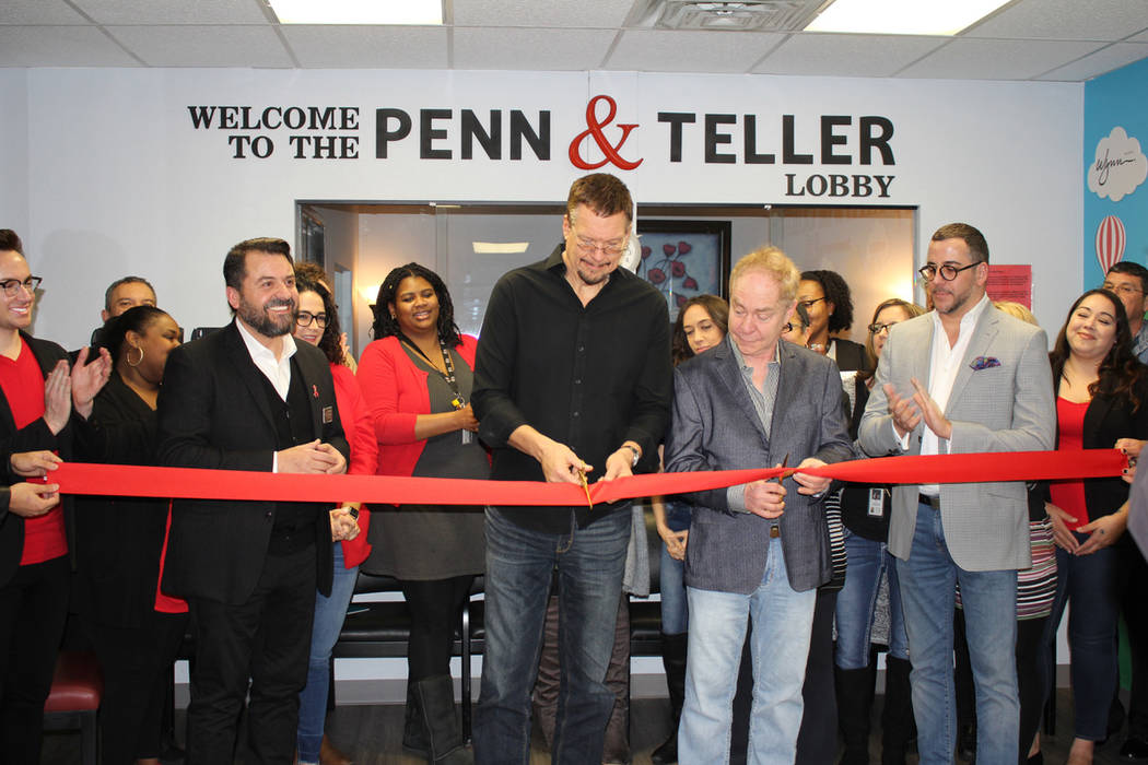 Penn Jillette of Penn & Teller cuts the ribbon in the lobby of the new AFAN headquarters on Wednesday, Feb. 7, 2019. (Aid for AIDS of Nevada)