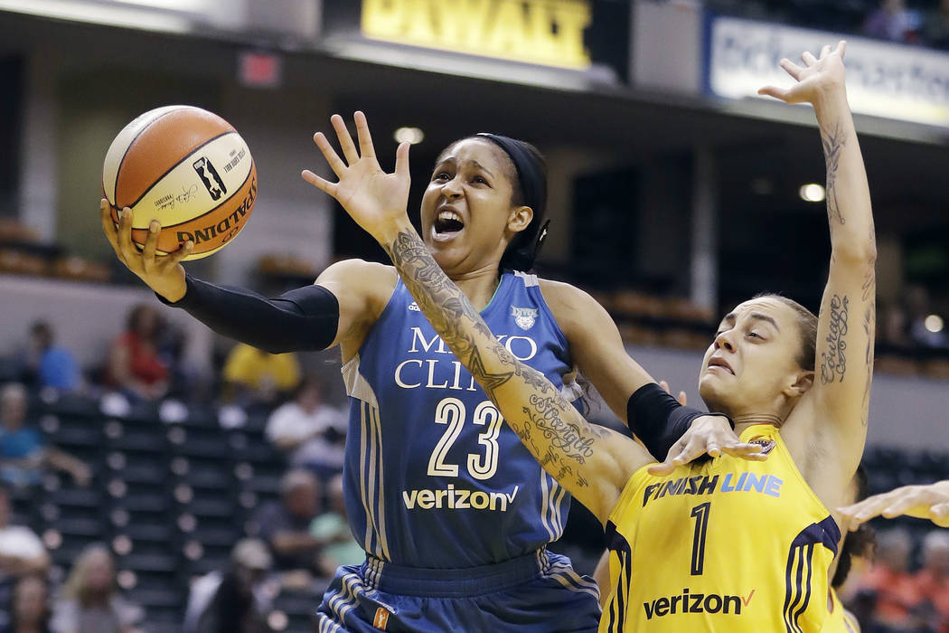 In this Aug. 30, 2017, file photo, Minnesota Lynx's Maya Moore, left, shoots against Indiana Fever's Jazmon Gwathmey during the first half of a WNBA basketball game in Indianapolis. Minnesota Lynx ...