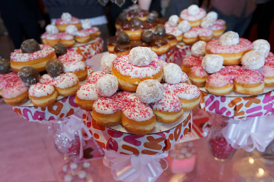 Dunkin' Donuts' bouquets are seen during a doughnut-themed wedding event in downtown Las Vegas, Saturday, Feb. 9, 2019. Dunkin' Donuts spreads some love at Sure Thing Chapel to give out donut bou ...