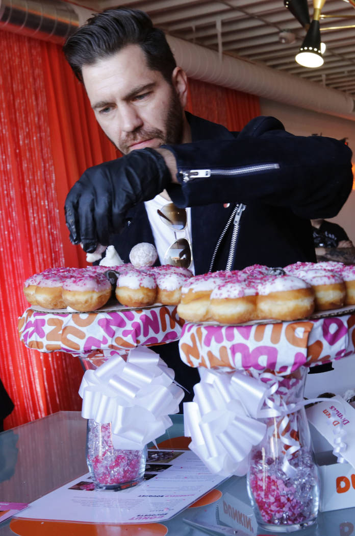 Pop artist Andy Grammer makes a donut bouquet during a doughnut-themed wedding event in downtown Las Vegas, Saturday, Feb. 9, 2019. Dunkin' Donuts spreads some love at Sure Thing Chapel to give ou ...