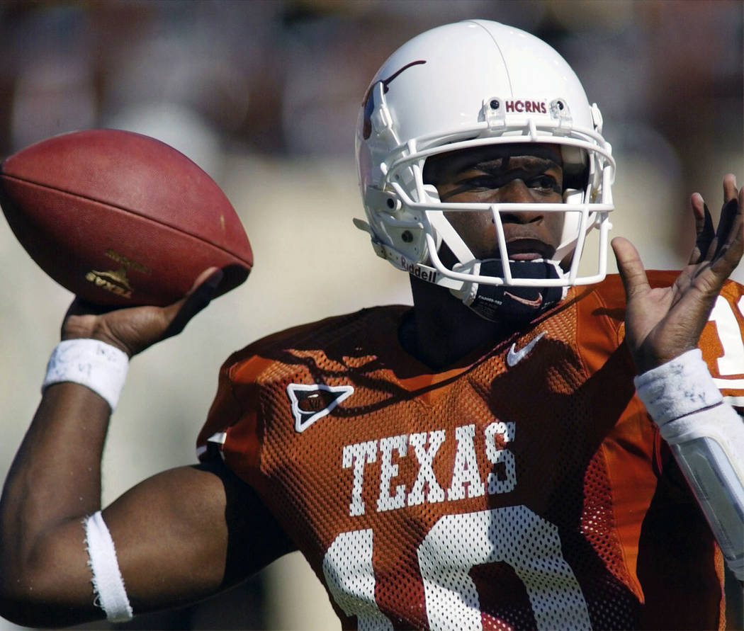 In this Oct. 16, 2004, file photo, Texas NCAA college football quarterback Vince Young looks for a receiver during the first half against Missouri, in Austin, Texas. Texas quarterback Vince Young ...