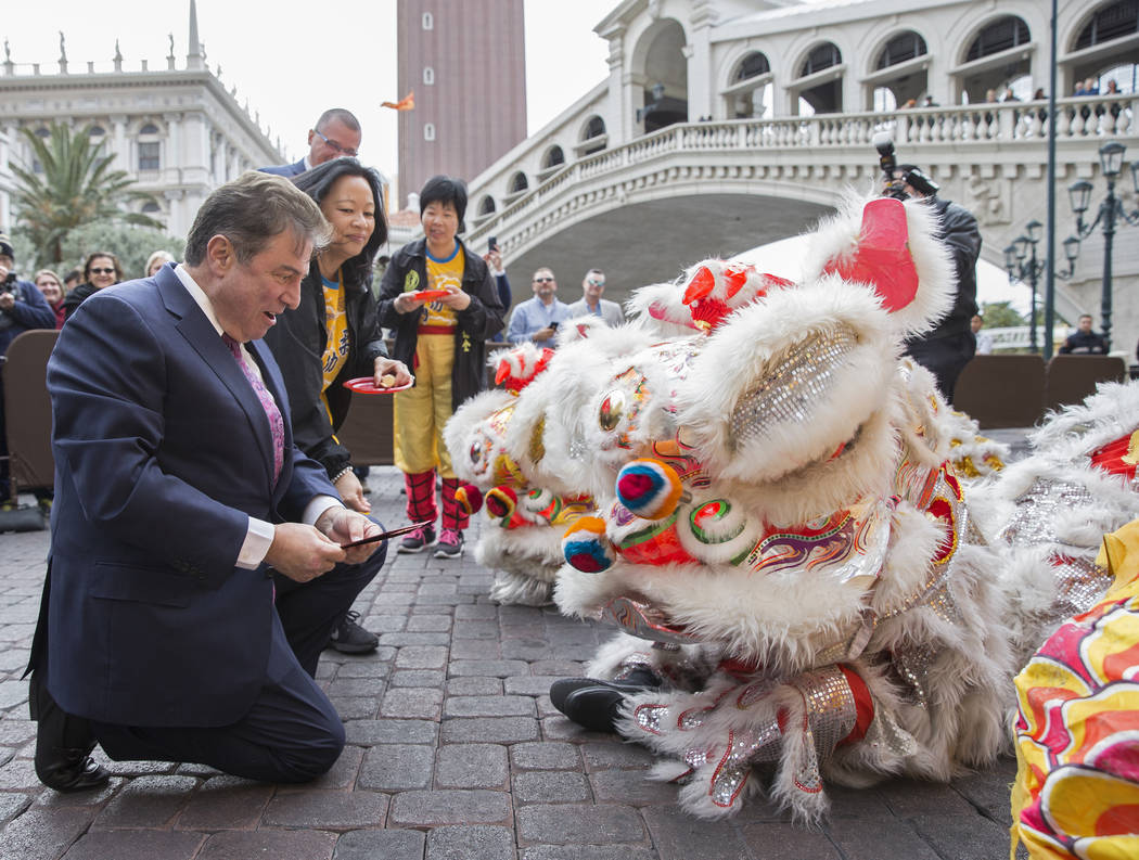 George Markantonis, left, president and chief operating officer with The Venetian, participates in an eye ceremony celebrating the Lunar New Year on Tuesday, Feb. 5, 2019, outside The Venetian, in ...