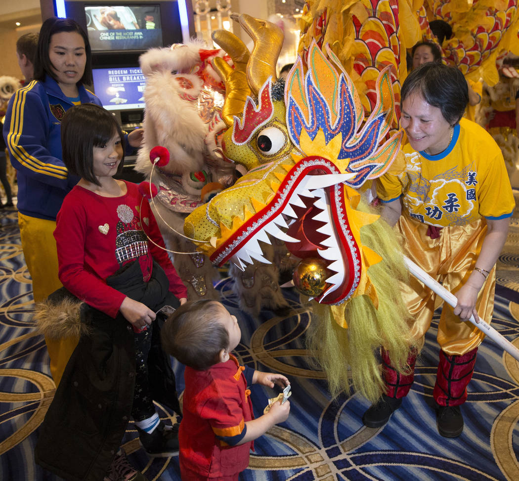 Performers with Yau Kung Moon Lion and Dragon Dance Troupe, from San Francisco, Calif., entertain the crowd with a ceremonial lion dance celebrating the Lunar New Year on Tuesday, Feb. 5, 2019, a ...