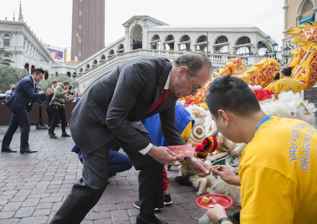 Pete Boyd, left, senior vice president of operations with The Venetian, participates in an eye ceremony celebrating the Lunar New Year on Tuesday, Feb. 5, 2019, at The Venetian, in Las Vegas. (Ben ...