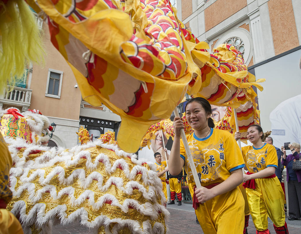 Performers with Yau Kung Moon Lion and Dragon Dance Troupe, from San Francisco, Calif., celebrate the Lunar New Year with a ceremonial lion dance on Tuesday, Feb. 5, 2019, outside The Venetian, in ...
