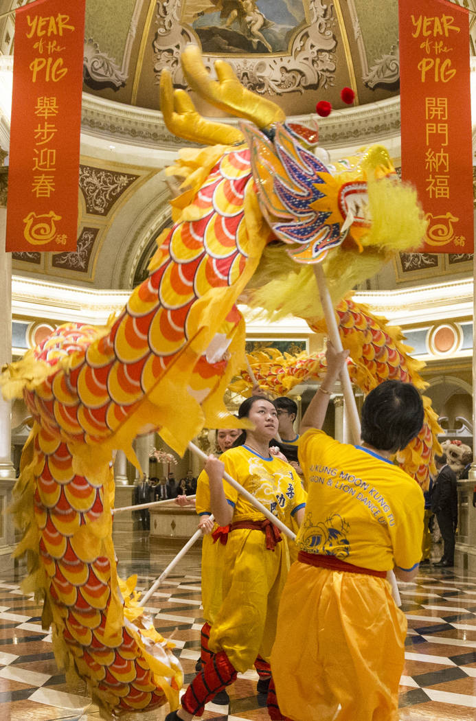 Performers with Yau Kung Moon Lion and Dragon Dance Troupe, from San Francisco, Calif., celebrate the Lunar New Year with a ceremonial lion dance on Tuesday, Feb. 5, 2019, at The Venetian, in Las ...