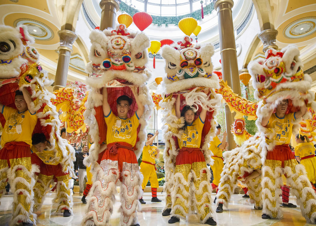 Performers with Yau Kung Moon Lion and Dragon Dance Troupe, from San Francisco, Calif., celebrate the Lunar New Year with a ceremonial lion dance on Tuesday, Feb. 5, 2019, at Palazzo, in Las Vegas ...