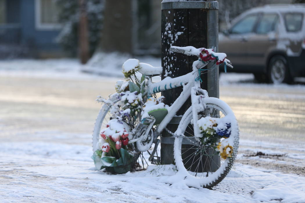 A snow and ice covered bicycle on the sidewalk Tuesday, Feb. 5, 2019 in Portland, Ore. Portland got 1.5 inches of snow overnight into Tuesday, according to the National Weather Service. Snow, ice ...