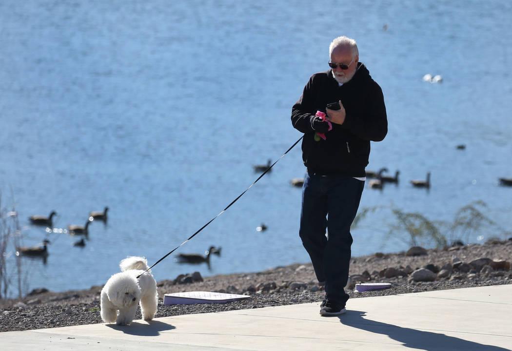 Rod George walks his dog, Chloe, during a cold morning at Cornerstone Park on Wednesday, Feb. 6, 2019, in Henderson. (Bizuayehu Tesfaye/Las Vegas Review-Journal) @bizutesfaye