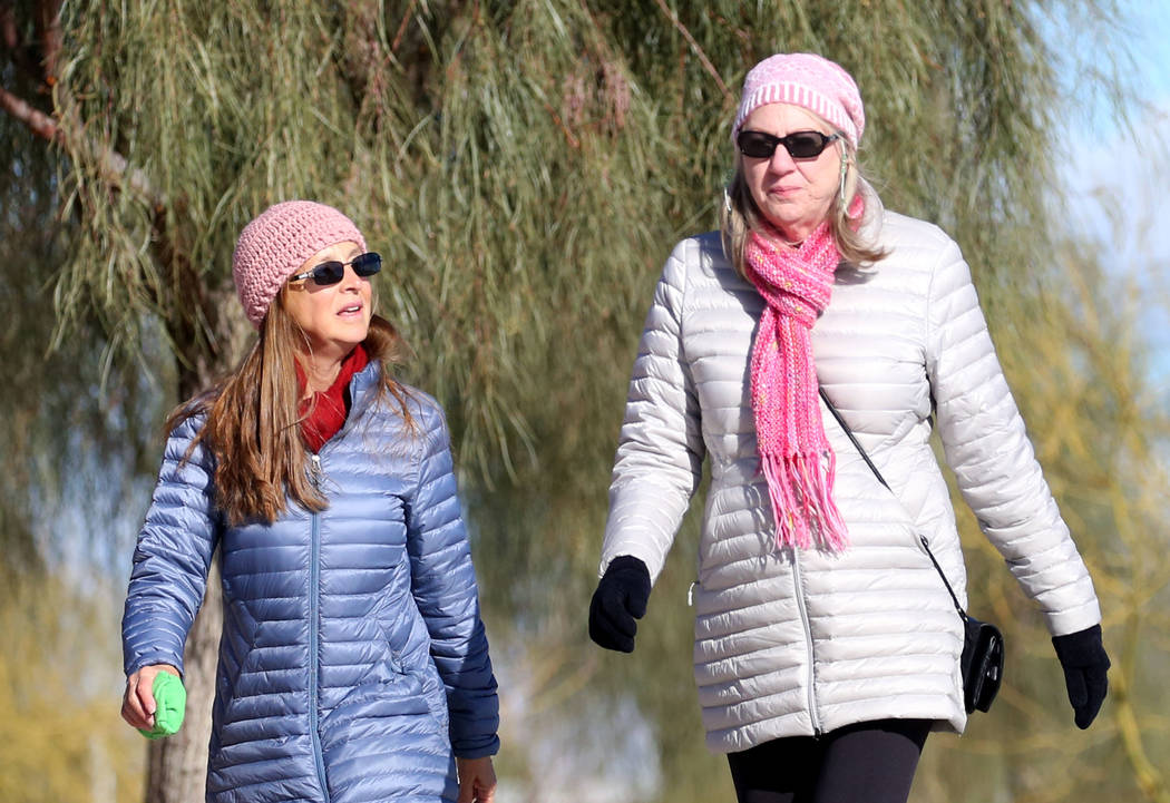Tina Daley, left, and Rochelle Zawisza of Henderson bundled up as they walk during a cold morning at Cornerstone Park on Wednesday, Feb. 6, 2019, in Henderson. (Bizuayehu Tesfaye/Las Vegas Review- ...