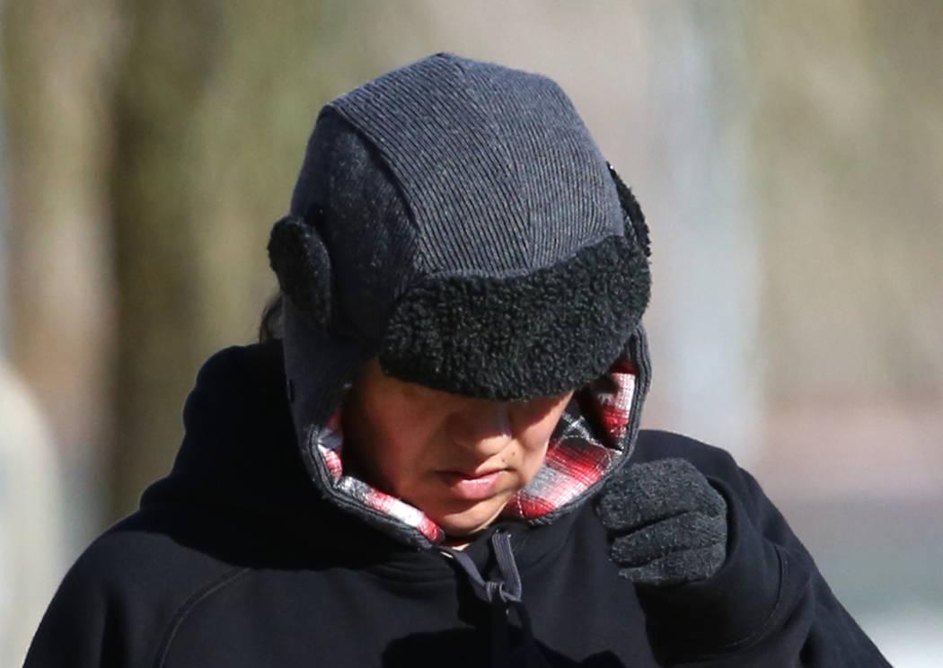 A woman is bundled up as she walks during a cold morning at Cornerstone Park on Wednesday, Feb. 6, 2019, in Henderson. (Bizuayehu Tesfaye/Las Vegas Review-Journal) @bizutesfaye