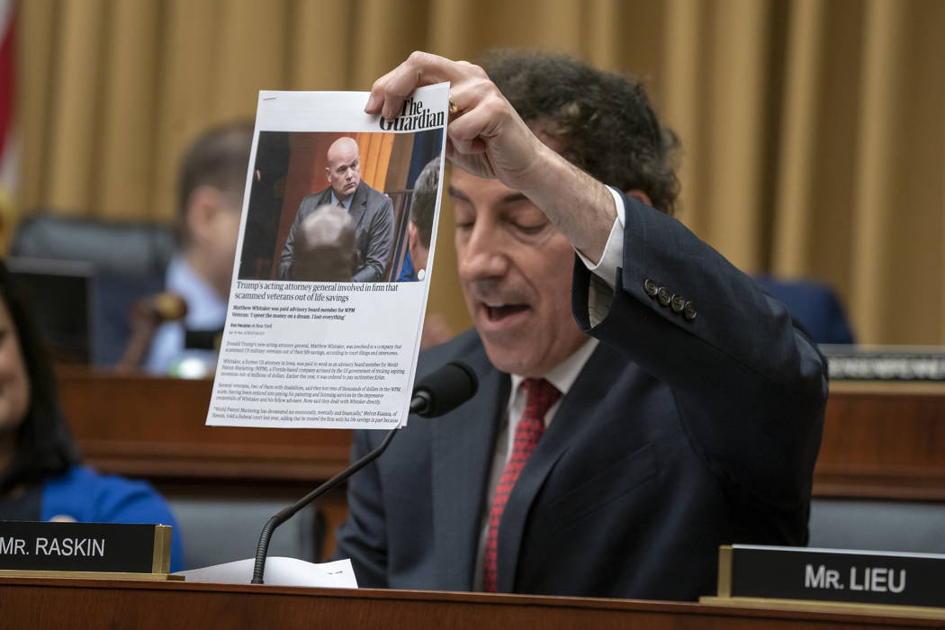 Rep. Jamie Raskin, D-Md., holds up a paper as he questions Acting Attorney General Matthew Whitaker as he testifies before the House Judiciary Committee on Capitol Hill, Friday, Feb. 8, 2019 in Wa ...