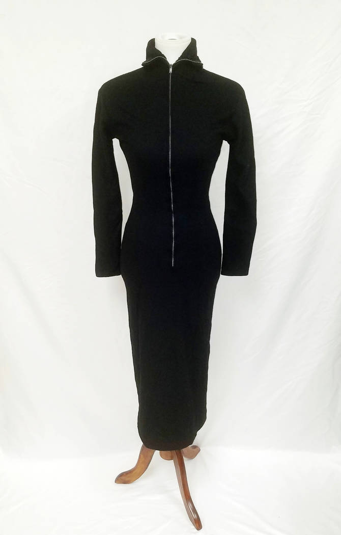 This undated image released by GWS Auctions shows a black dress that actress Marilyn Monroe wore to a 1954 press conference announcing her separation from baseball legend Joe DiMaggio. KruseGWS Au ...