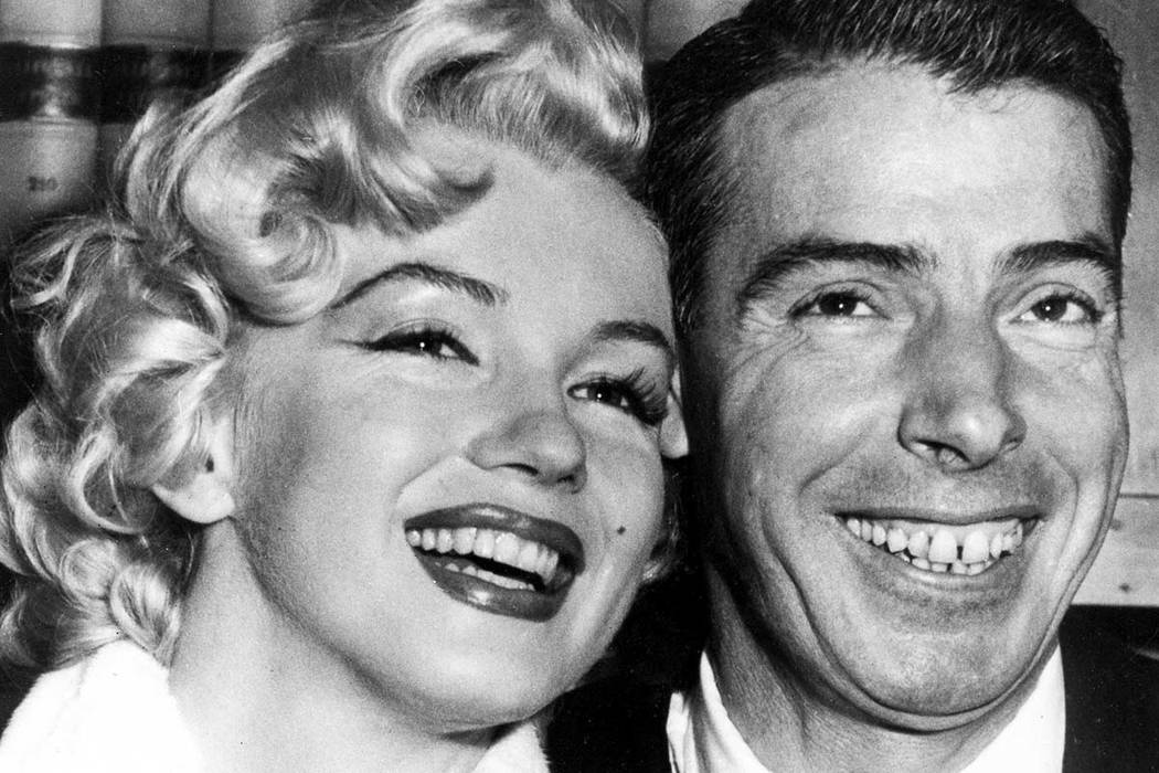 In this Jan. 14, 1954 file photo, New York Yankees' Joe DiMaggio poses with actress Marilyn Monroe, as they wait for their marriage ceremony in San Francisco. The black dress that a distraught Mar ...
