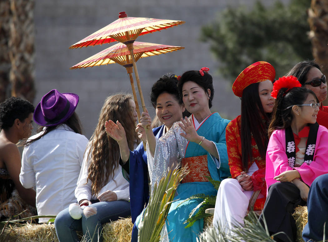 People wait on a float during the Chinese New Year parade on 4th Street in Las Vegas on Sunday, February 9, 2014. The parade is in its second year of existence and had approximately 30 floats. (Ju ...