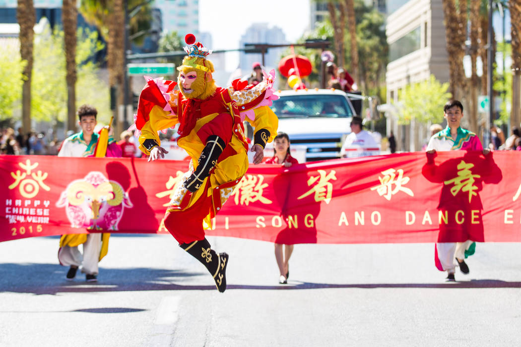Shao Yong Bao, dressed as Sun Wukong, or Monkey King, performs with the Anhui Song and Dance Ensemble, from the Anhui province in China, during the Chinese New Year parade on Fourth Street in down ...