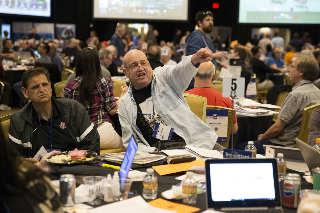 Alan Hasher, center, a competitor in the National Horseplayer Championship, watches a horse race at the Treasure Island casino-hotel in Las Vegas, Friday, Feb. 9, 2018. Erik Verduzco Las Vegas Rev ...