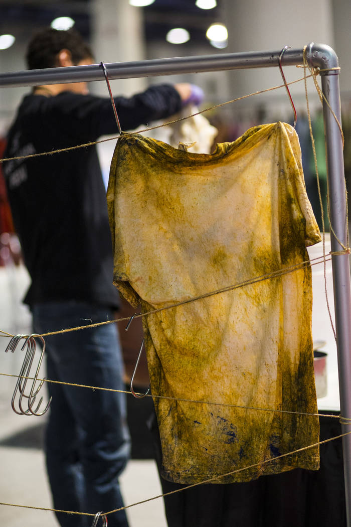 A shirt dyed with eco-friendly materials from Tintes Egara is hung up to dry during the Sourcing at MAGIC trade show at the Las Vegas Convention Center in Las Vegas on Wednesday, Feb. 6, 2019. (Ch ...