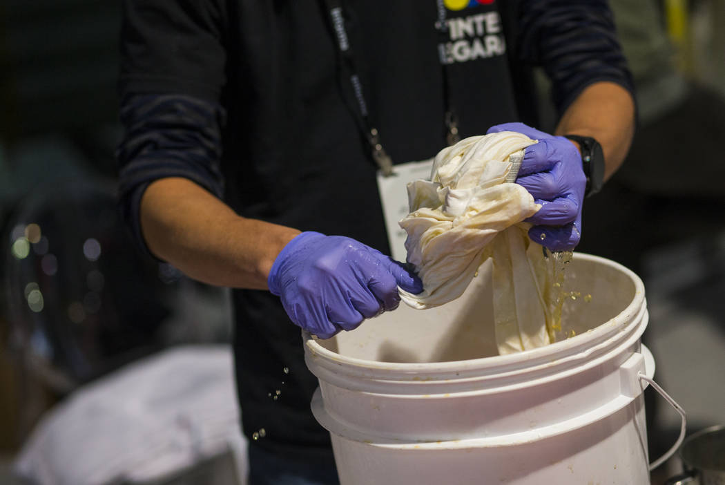 Josep Segura of Tintes Egara hand-dyes a shirt using eco-friendly materials during the Sourcing at MAGIC trade show at the Las Vegas Convention Center in Las Vegas on Wednesday, Feb. 6, 2019. (Cha ...