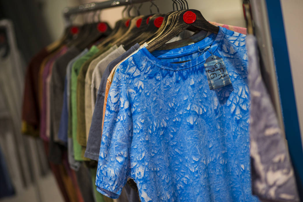 Shirts dyed with eco-friendly materials from Tintes Egara are displayed during the Sourcing at MAGIC trade show at the Las Vegas Convention Center in Las Vegas on Wednesday, Feb. 6, 2019. (Chase S ...