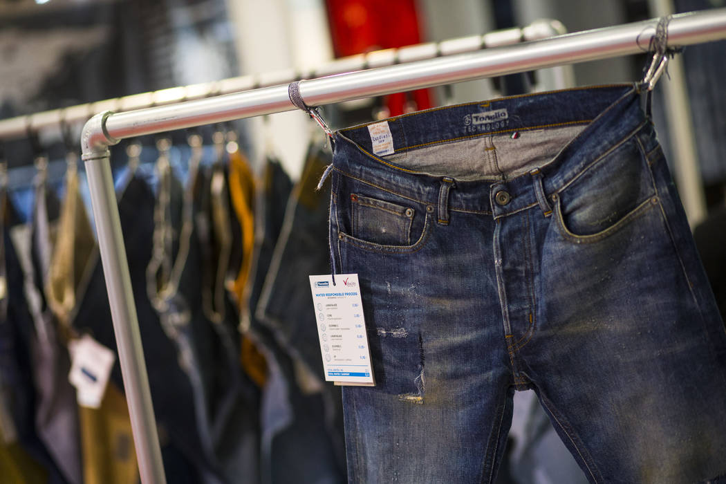 Jeans made using sustainable garment treatment by Tonello and Velocity Apparelz on display during the Sourcing at MAGIC trade show at the Las Vegas Convention Center in Las Vegas on Wednesday, Feb ...