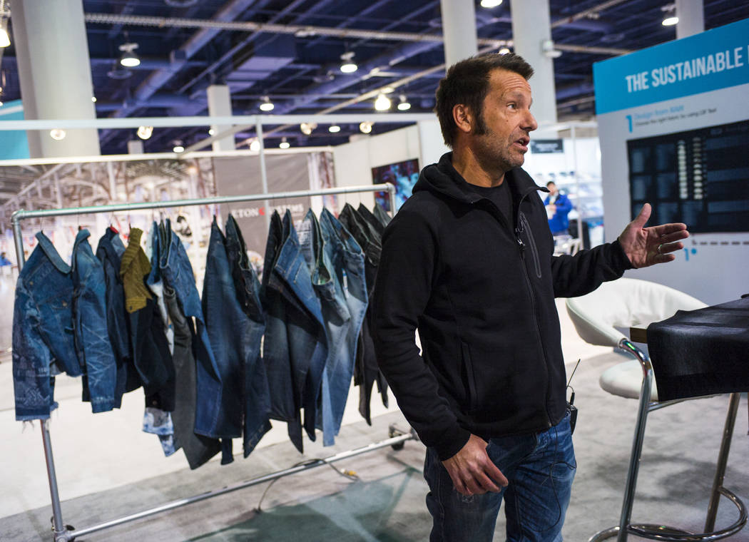 Alex Penades, brand manager at Jeanologia, talks about the benefits of using eco-friendly technology in the production of jeans and other apparel during the Sourcing at MAGIC trade show at the Las ...